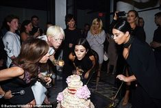 Celebration: The stars were spotted blowing out a pretty cake