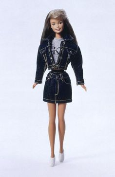 Barbie's Best Outfits In Honor of Her 56th Birthday-Calvin Klein Barbie® released in 1996 - What could be hipper? It's a very cool Barbie® doll dressed from head to toe in Calvin Klein designer clothes. She wears a real denim skirt with an authentic CK label and her trendy grey crop top is covered by a denim jacket. Her accessories include an adorable back pack, a CK windbreaker with, of course, a big Calvin Klein logo on the back, sneakers and a baseball cap.