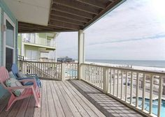 COSMOPOLITAN - This is a very well maintained duplex. The downstairs or first level has an open living and dining area, a fully equipped kitchen, a half bath and a bedroom with a King size bed and private bath. The upstairs has 4 bedrooms and 3 baths. There are two Gulf front master suites with King size beds and private baths, a bedroom with a Queen bed and a bedroom with two sets of Twin bunk beds. These rooms share a bath.