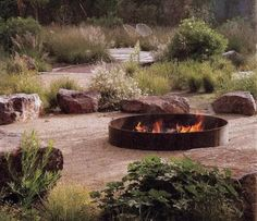 A simple metal fire ring can often make the best outdoor setting idea. We love the oversized round design – it just seems so natural, for a fire pit to be round and big. Metal Fire Pit, Diy Fire Pit, Fire Pit Backyard, Outside Fire Pits, Fire Pit Materials, Types Of Fire, Fire Pit Seating, Seating Areas, Fire Pit Furniture