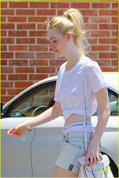 Elle Fanning Boasts Creatures Of The Wind Fashion Brand: Photo Elle Fanning arrives for a hair appointment at Ramirez Tran Salon on Thursday afternoon (July in Los Angeles. The actress showed off her Calvin… Dakota Fanning Y Elle, Ramirez Tran Salon, Calvin Klein Underwear, Belle Photo, Hollywood Actresses, Girl Crushes, Fashion Brand, Celebrity Style, Ideias Fashion