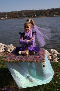 Genie on a Magic Carpet - Homemade Illusion Costume TOO CUTE!! As much as I loved I Dream of Jeannie as a kid, this would have been a MUST!! I always had to be a doctor, a hobo, or a clown!! lol OR-if we wanted to buy a costume I could do Wonder Woman or a witch!! WOO HOO