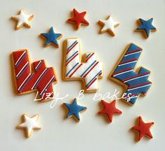 Fourth of July decorated sugar cookies. Royal icing. Red, white, blue. Star, number four, 4. Stripes.
