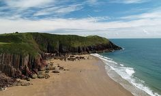 Wales is blessed with a spectacular coastline. Rob Smith, author of Secret Beaches Wales, picks 10 of the most secluded, and where to eat nearby