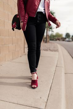 Still looking for a holiday party outfit? This tough-girl look is the perfect casual holiday outfit inspiration. Love black denim with a colored leather jacket. And red heels seal the deal!