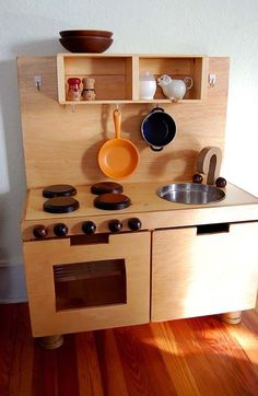 We thought 2008 was the Year of the DIY Play Kitchen, but Ohdeedoh readers weren't done! Here's a terrific one from Surya and Dave who lovingly made this for their daughter. They were inspired by this play kitchen, made from Ikea components, but don't happen to live near an Ikea (many of you can relate we're sure). No problemo - they found plenty of other good resources.