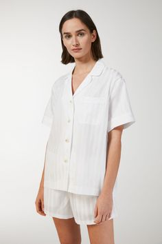 Woven with a tonal satin stripe, this cotton pyjama shirt has a feminine look with short sleeves and classic lapels. Cut in a relaxed, straight fit with sl
