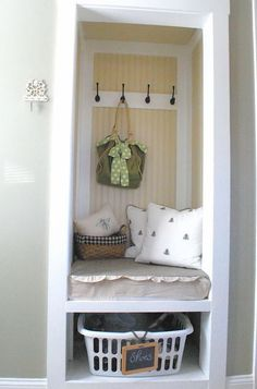 Now this is useful: transform an underused closet into a seating / coat / shoes area. The white trim and yellow strips make THIS space fabulous (traditional closet by The Shabby Nest).