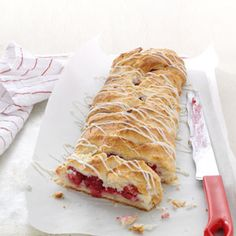 Raspberry Breakfast Braid ~ 2 cups biscuit/baking mix, 3 ounces cubed cream cheese, 1/4 cup cubed cold butter, 1/3 cup milk, 1-1/4 cups fresh raspberries, 3 tablespoons sugar ~ Glaze ~Mix 1 tablespoon each of cream cheese and butter, 1 cup powdered sugar, 1 teaspoon vanilla and enough milk to make the frosting smooth ~ Spread over entire braid when it is still a bit warm!