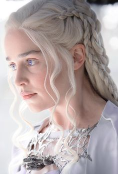 Daenerys Targaryen ~ Game of Thrones I just noticed she carries three little dragon heads with her.