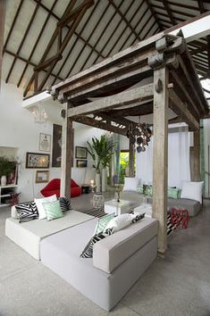 Living room of Valentina Audrito's Home Bali.A Tropical Rustic Modern dream house is a traditional joglo updated.