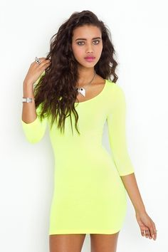 I seen JLo pair a neon green dress with neon pink pumps without looking trashy. I want to re-create that look.