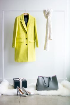 Gift her from head-to-toe this holiday season. Mix our long bold citron green coat with a soft textured gray cashmere scarf, classic gray leather tote bag, and silver metallic heels | Banana Republic Gifted Guide