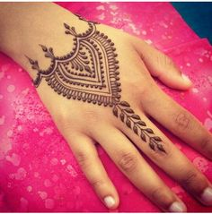 lovely henna design for the back of a hand