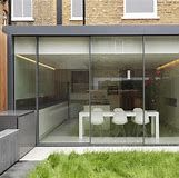 The minimal windows® sliding doors are exclusively available from IQ Glass in the UK. The beauty of this system is in the frameless aesthetic that can be achieved. Exterior Sliding Glass Doors, Sliding Door Room Dividers, Exterior Barn Doors, Room Divider Doors, Sliding Doors, Closet Doors, House Window Design, Door Design, Modern Exterior