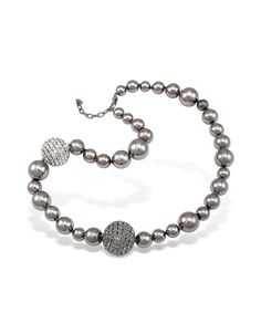 Glittering SWAROVSKI ELEMENTS embellishing large ball beads add sparkle and glamour to dark silver mirror-polished beads in various sizes for a look of true couture panache. Signature box included. Made in Italy. #jewelry #fashion #style #women #decoration #gem