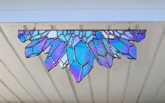 I am absolutely swooning for this design! This crystal piece has over 17 individual detailed crystals all clustered together Perfect for all us crystal lovers in any window or entrance way!! She measures roughly 18 inches wide with her center crystal jutting to 8 inches she has