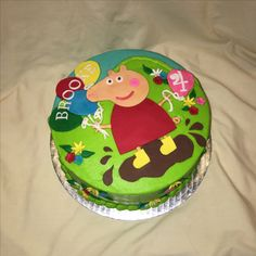 Peppa Pig muddy puddle birthday cake fondant by Inphinity Designs. Please visit my FB page Inphinity Designs at https://m.facebook.com/profile.php?id=71791500352&refsrc=https%3A%2F%2Fwww.facebook.com%2Fpages%2FInphinity-Designs%2F71791500352