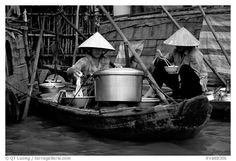 Boat-based food vendors. Can Tho, Mekong Delta, Vietnam. Real Vietnamese food on the go.