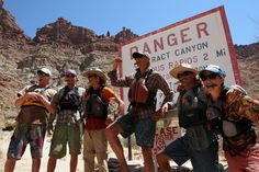 (Francisco Kjolseth  |  The Salt Lake Tribune)  Fearless river guides grit their knives between their teeth as Julian Springer, Justin Malloy, Christian Wright, Brin Finnigan, Alex Jahp and Lauren Wood ready themselves to take on the rapids after signing in at the campsite registration box at mile 214.4 that marks the start of Cataract Canyon.