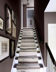 This stairway is covered with an antique Turkish rug, customized into a runner.