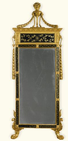 An Italian carved giltwood and verre eglomisé mirror, possibly Lucca, first quarter 19th century | Lot | Sotheby's
