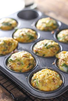 Breakfast Egg Muffins - A quick and easy way to get your eggs to go. Loaded with bacon bits, cheddar cheese and spinach!