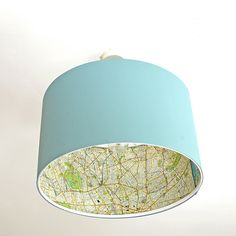 In this ridiculously easy Ikea lamp hack, learn how to decoupage the inside of a lampshade so you get a hint of map when you look up at these ceiling lamps. Pillar Box Blue featured on Kenarry.com