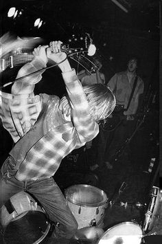 Kurt Cobain smashes guitar, New York, NY, April 26, 1990, via Flickr.