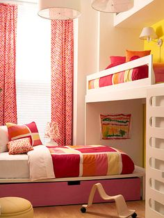 A small space becomes suitable for two kiddos. Tour the rest of this space here: http://www.bhg.com/rooms/kids-rooms/shared-rooms/girls-modern-pink-bedroom/?socsrc=bhgpin062912#page=5