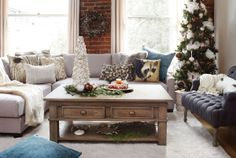 I SPY a tree, but not the one you think. A critter on the sofa and one on the chair that's actually an owl with very long hair. There's faux fur and real cheese and beautiful tree ornaments that are sure to please.   Featured: Liberty Sectional Combo - Polo Grey, Settler Coffee Table, Tristan Tufted Arm Chair, Custom Manhattan Shag Rug - Milk  Shop this room: http://www.urbanbarn.com/products/New/Shop-this-Timeless-Christmas-Room