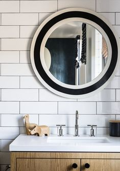 There's nothing childish about this kids' bathroom, with its strong modern lines, floor- to-ceiling subway tiles and neutral color palette. Purist faucet from Kohler.