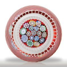 Peter McDougall Glass Studio millefiori swirl faceted paperweight.(280) images