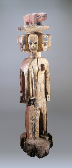 Title: Multi headed Bush Spirit Guardian Figure  Artist/Origin: Ijo Peoples, Nigeria  Region: Nigeria  Material: wood, pigment  Dimensions: 62 x 15 x 15 in.  On view in the museum
