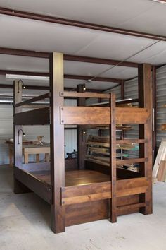 Custom Queen over Queen bunk beds, knotty alder construction, Gunstock finish, integrated ladder, low voltage lighting, and full size trundle pullout bed below lower bunk. Delivered to Mendham, New Jersey.