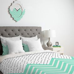 white bedroom with gray and mint green accents, pantone lucite green, mint and white chevron duvet cover, black and white polka dots, gray upholstered headboard