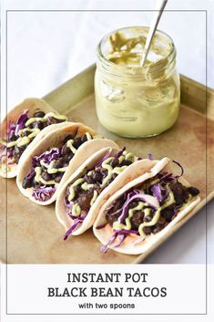 Instant Pot Black Bean Tacos with Avocado Crema will be your new favorite make-ahead taco recipe! #WithTwoSpoons #tacos #InstantPot #PressureCooking #blackbeans #avocodocrema #butternutsquash
