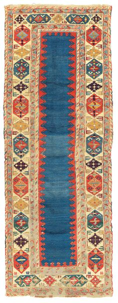 A DAGHESTAN RUNNER A NORTH EAST CAUCASUS, LATE 18TH CENTURY 8ft.6in. x 3ft.2in. (258cm. x 96cm.) £18,000-24,000