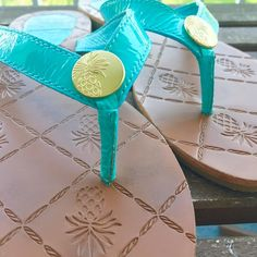 Tommy Bahama Flip Flops Tommy Bahama Flip Flops, in great condition, turquoise color straps with gold coin at thong that has the signature pineapple stamp. Size 8 Tommy Bahama Shoes Sandals