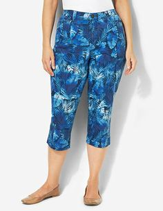 Palm Tree Denim Capri: Freshen up your everyday look with this stylish capri in a refreshing palm tree print. Features three square pockets on the front and back patch pockets. Complete with a zip opening and flourish-embossed button closure. catherines.com #catherines #summerstyle #plussizefashion #plussizecapris