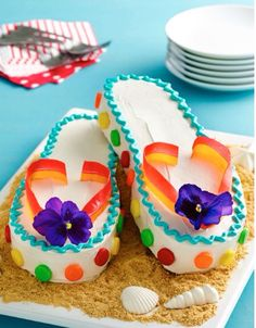 This fashionable and fun cake will make the little ones feel like they?re relaxing right on the beach! Fruit by the Foot and chewy fruit candies add bright pops of color Unique Cakes, Creative Cakes, Fancy Cakes, Cute Cakes, Flip Flop Cakes, Flip Flops, Beautiful Cakes, Amazing Cakes, Beach Cakes