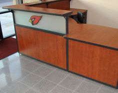 Incorporate logos into your design with reception desks by Interior Concepts.