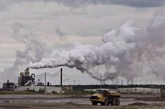 In this file photo, a dump truck works near the Syncrude oil sands extraction facility near the city of Fort McMurray, Alta., on June The Trudeau government has announced how its carbon-pricing plan will work. Oil Sands, Paris Climate, Greenhouse Gases, Oil And Gas, Global Warming, Climate Change, Environment, In This Moment, Federal