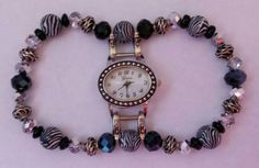 Small vintage pearl watch face with zebra, black,  silver, and black metal beads