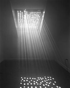 Abelardo Morell - Contact. The setting is clever in my opinion. The light rays in this low key photo look interesting to me.