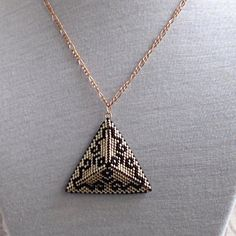 Geometric reversible peyote pyramid pendant necklace on an rose gold coloured chain; gold and black Egyptian style Seed Bead Jewelry, Bead Earrings, Beaded Jewelry, Beaded Necklace, Pendant Necklace, Unique Jewelry, Triangle Earrings, Seed Bead Patterns, Beading Tutorials