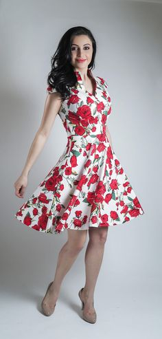 Beautiful floral summer dress with red roses in a white background. This dress is very elegant with a vintage look, and it is ideal for countless occasions, a key piece for your summer capsule wardrobe, which will be expertly handmade to your precise measurements.  Made with cotton sateen (97% cotton, 3% spandex) it has a soft silkier feel to it, the spandex gives this dress the right amount of stretch for a better fitting.  The dress is fitted at the top and has a high collar, cap sleeves…
