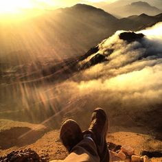 Sitting at the edge of Mt. Moses in Egypt at the break of day after an all-night hike 💙💙 Photo Credit - daria