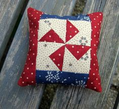 Little Pinwheel Pincushion by Kathleen Tracy http://www.countrylanequilts.com/