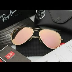 Ray-Ban Gold with Pink Trim Aviator Sunglasses These Ray-Ban Sunglasses are flawless! They are like new, excellent used condition. They are gold with a light-pink, mirror lens that makes them even mor